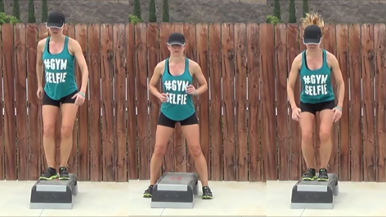 Personal trainer deomonstrating straddle jump on a step