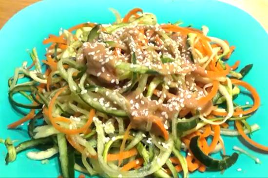 Peanut butter salad dressing over vegetable spirals