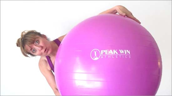 personal trainer with pink stability ball