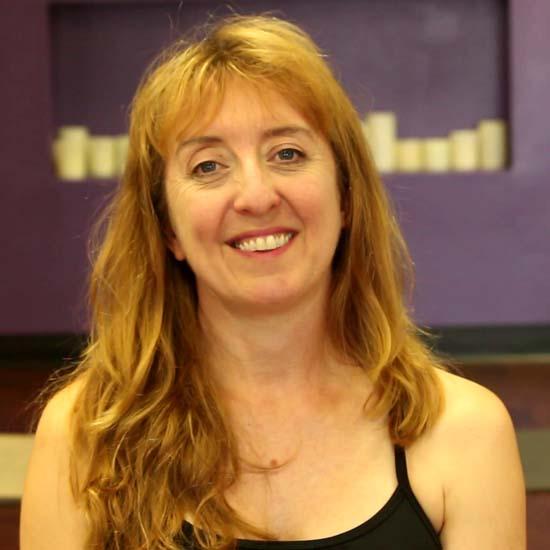 female yoga teacher smiling