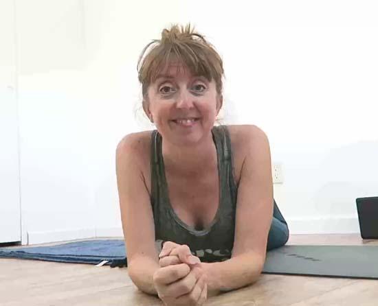 pilates teacher on yoga mat