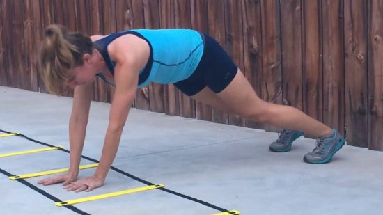 personal trainer demonstrating agility ladder core workout
