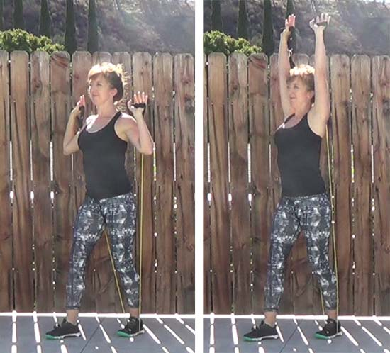 Personal trainer performing overhead press with resistance band