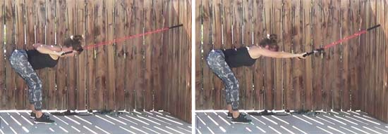 Personal trainer performing bent over lat pull down with resistance band