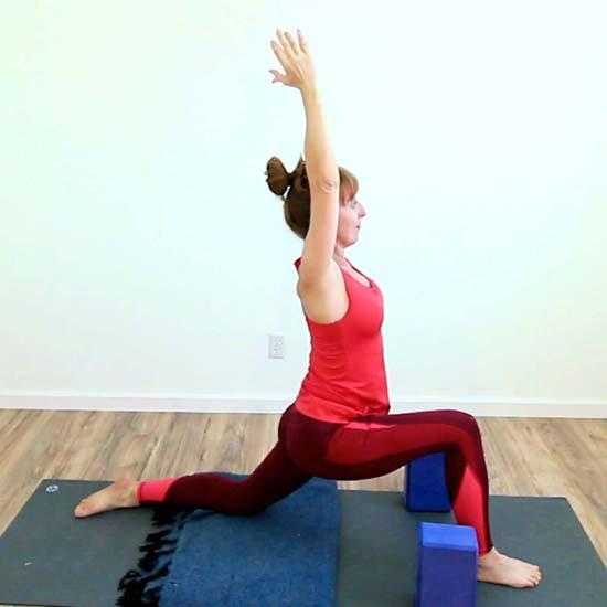 Yoga teacher side view of low lunge pose anjaneyasana