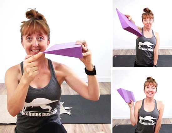 Yoga teacher holding a yoga wedge block