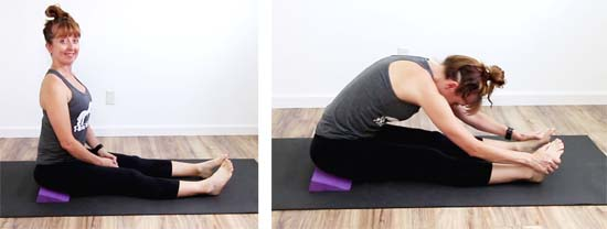yoga teacher sitting on a yoga wedge to elevate the hips in dandasana and paschimottonasana