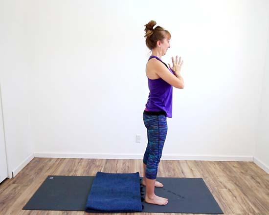 yoga teacher standing in tadasana, mountain pose