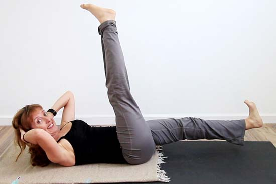 yoga teacher in supine warrior three crunch
