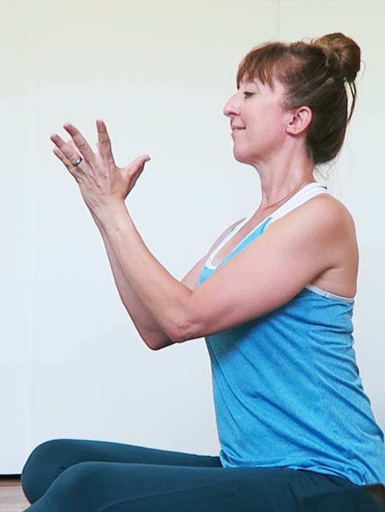 Profile photo of seated yogi in lotus mudra
