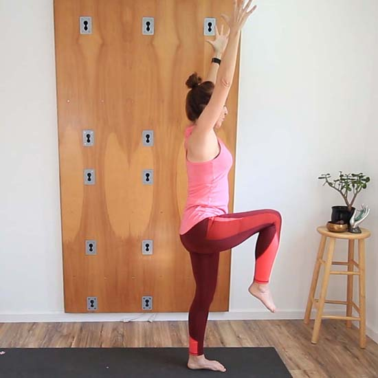 Standing balance pose, on one leg with the opposite knee bent and thigh at hip height.