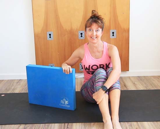 di hickman seated on yoga mat with clever yoga balance pad