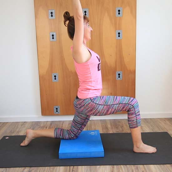 Using yoga balance pad under knee in modified lunge