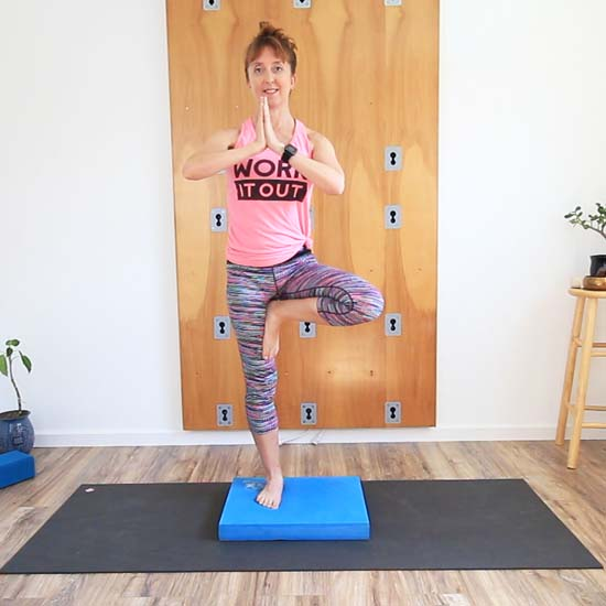standing on the balance pad in tree pose (Vrksasana)