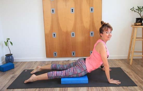 using the balance pad under the pelvis in upward facing dog