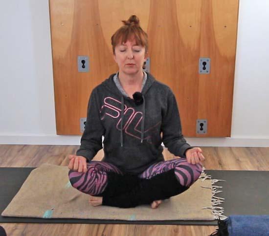 sitting in sukhasana, seated yoga pose