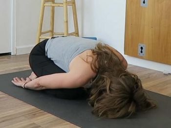 Yoga teacher in Childs pose