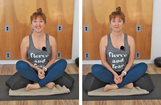 demonstrating yoga wedges under thighs in seated position