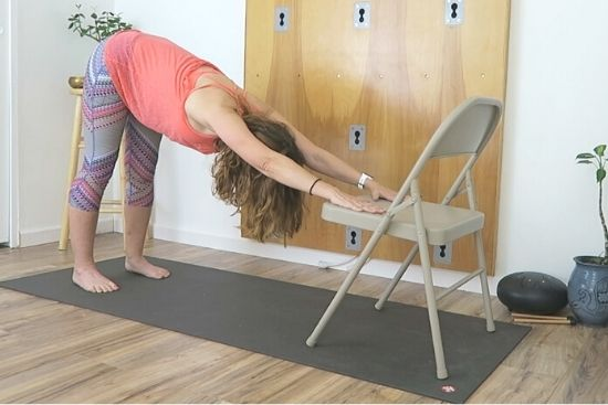 downward facing dog using an office chair