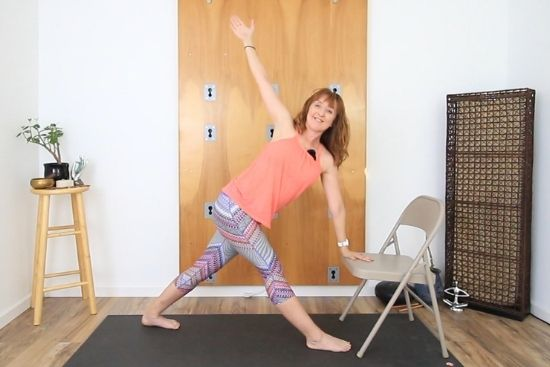 revolved triangle yoga pose using an office chair