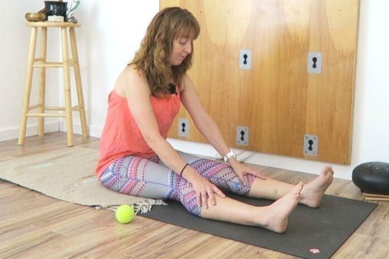 yoga teacher sitting in dandasana