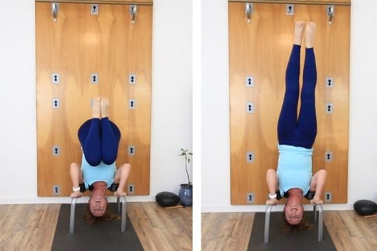 yoga teacher coming into a headstand with headstand bench