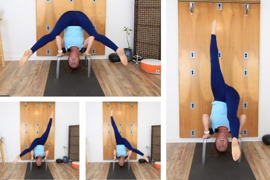 yoga teacher doing core exercises with headstand bench