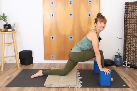 low lunge with hands on blocks