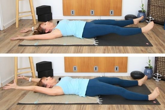 lying supine on floor both legs lifted, and both arms lifted